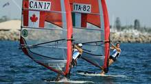 Nikola Girke of Canada and Veronica Fanciulli of Italy compete in the RS:X Women's Windsurfer event at the ISAF World Sailing Championships off Fremantle on December 5, 2011. (GREG WOOD/AFP/Getty Images)