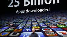 Apple CEO Tim Cook speaks about the number of apps downloaded during an Apple event in San Francisco, March 7, 2012. (Robert Galbraith/Reuters/Robert Galbraith/Reuters)