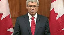 'This week's events are a grim reminder that Canada is not immune to the types of terrorist attacks we have seen elsewhere around the world,' Prime Minister Stephen Harper says in televised address on Oct. 22, 2014. (Associated Press)