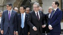 Participants of the G7 finance ministers and central bankers meeting prepare for a family picture in Palace Chapel in Dresden, Germany, May 28, 2015. During a conference call with reporters, Mr. Oliver said the vast majority of Canadians are already saving enough for retirement, pointing to a survey released earlier this year by consulting firm McKinsey & Co. that found 83 per cent of Canadians polled said they are on track to maintain their existing standard of living in retirement. (Fabrizio Bensch/Reuters)