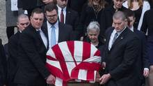 Maureen McCarthy Scalia follows her husband's casket as it is lead out of church after the funeral Mass for US Supreme Court Justice Antonin Scalia at the Basilica of the National Shrine of the Immaculate Conception in Washington, DC, on February 20, 2016. (NICHOLAS KAMM/AFP/Getty Images)