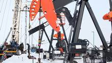 Workers with EOG Resources operate a service rig southeast of Waskada. The rigs run 24 hours a day, seven days a week. (Tim Smith for The Globe and Mail/Tim Smith for The Globe and Mail)