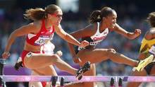 Lolo Jones (L) of the U.S. and Canada's Phylicia George compete during their women's 100m hurdles round 1 heat during the London 2012 Olympic Games at the Olympic Stadium August 6, 2012. (MARK BLINCH/REUTERS)