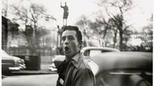 "A photo of the author wandering along New York's East 7th Street featured in the ""Beat Memories"" show at the National Gallery of Art. (THE ALLEN GINSBERG LLC/NYT)"