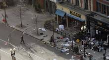 Debris is seen along Boylston Street after explosions went off at the 117th Boston Marathon in Boston, Massachusetts April 15, 2013. Two explosions hit the Boston Marathon as runners crossed the finish line on Monday. (JESSICA RINALDI/Reuters)