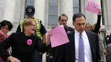 In this Oct. 6, 2008 file photo, Lehman Brothers CEO Richard Fuld is heckled by protesters as he leaves Capitol Hill in Washington after testifying before the House Oversight and Government Reform Committee on the collapse of Lehman Brothers. (Susan Walsh/Associated Press)