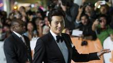 Jang Dong-gun poses for photographs on the red carpet at the gala for the new movie Dangerous Liaisons during the 37th annual Toronto International Film Festival on Sept. 10, 2012. (Nathan Denette/THE CANADIAN PRESS)