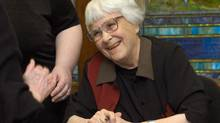 Harper Lee signs books at the University of Alabama in January, 2006. Surprised and distracted by the publicity from To Kill a Mockingbird, Ms. Lee started declining interviews, giving her last in 1964. (DANA MIXER/NYT)