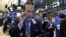 Trader Gregory Rowe works on the floor of the New York Stock Exchange, Wednesday, Oct. 5. (Richard Drew/AP)
