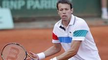 Canada's Daniel Nestor returns the ball and Belarus' Max Mirnyi, unseen, as they play Colombia's Juan Sebastian Cabal with Argentina's Eduardo Schwank during their men's doubles final match for the French Open tennis tournament at the Roland Garros stadium, Saturday June 4, 2011 in Paris. Guess Who singer Burton Cummings, film star Ryan Reynolds and comedian Russell Peters are among the latest inductees to Canada's Walk of Fame. Rounding out the list, announced this morning at a news conference, are astronaut Roberta Bondar, tennis star Nestor, actress Sandra Oh and author Mordecai Richler, who died 10 years ago. (Lionel Cironneau)