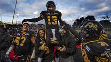 Tiger-Cats quarterback Dan LeFevour scored the winning touchdown in overtime during Sunday's East semi-final (MARK BLINCH/REUTERS)