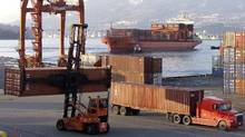 Trucks move containers in the port of Vancouver in this file photo. (Chuck Stoody/The Canadian Press)