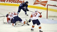 Winnipeg Jets' Evander Kane (9) scores his second goal of the game against the Florida Panthers during the second period of their NHL game in Winnipeg April 11, 2013. (FRED GREENSLADE/REUTERS)