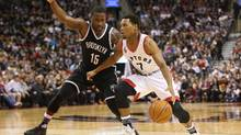 Jan 18, 2016; Toronto, Ontario, CAN; Toronto Raptors point guard Kyle Lowry (7) goes to the basket against Brooklyn Nets point guard Donald Sloan (15) at Air Canada Centre in Toronto on Jan. 18, 2016. Lowry will be in the starting lineup for the Eastern Conference next month at the NBA all-star game in Toronto. (Tom Szczerbowski/USA Today Sports)