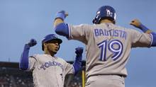 Jose Bautista and Edwin Encarnacion turned down $17.2-million qualifying offers from the Blue Jays. (Ben Margot/AP)