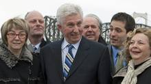 Bloc Quebecois Leader Gilles Duceppe poses with local candidates in Quebec City on April 1, 2011. (Jacques Boissinot/THE CANADIAN PRESS)