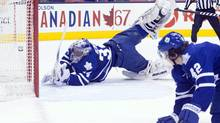 Toronto Maple Leafs goalie James Reimer dives in vain as he tries to stop a goal from Pittsburgh Penguins' Sidney Crosby as Leafs' Tyler Bozak looks on during first period NHL action in Toronto on Saturday, March 9, 2013. (Chris Young/THE CANADIAN PRESS)