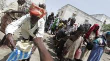 Somalis in Mogadishu line up for food being distributed by a local NGO called SAACID. (Peter Power/The Globe and Mail)