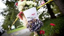 Bouquets of flowers tied to a pole serves as a memorial to Laura Szendrei, 15, in Delta September 27, 2010. Szendrei died early Sunday morning with her family at her side folowing an attack in a local park. (John Lehmann/The Globe and Mail/John Lehmann/The Globe and Mail)