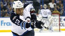 Winnipeg Jets' Dustin Byfuglien follows through on a shot during the first period of an NHL hockey game against the Tampa Bay Lightning on Thursday, Feb. 2, 2012, in Tampa, Fla. (Mike Carlson/AP)