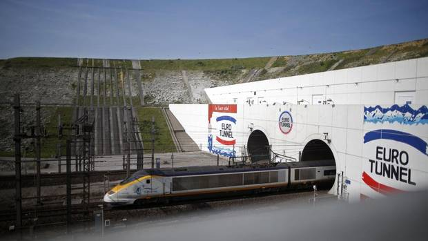 A high-speed Eurostar train exits the Channel Tunnel in Coquelles, near Calais. The project needed 12,000 engineers, technicians and workers for its construction. (CHRISTIAN HARTMANN/REUTERS)
