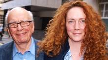 A file picture taken on July 10, 2011, shows Rebekah Brooks, right, former Chief Executive of News International and Rupert Murdoch Chairman of News Corporation in London. Rebekah Brooks, chief executive of Rupert Murdoch's News International, resigned Friday July 15, 2011, amid the phone-hacking scandal engulfing the British newspaper group, she said in a message to staff. (MAX NASH/MAX NASH/AFP/Getty Images)
