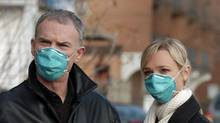 Ron White as Dr. Royce and Kari Matchett as Amy in the CTV original movie Plague City: SARS in Toronto