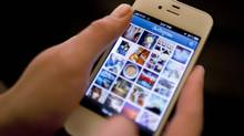 Instagram is demonstrated on an iPhone. (Karly Domb Sadof/AP)