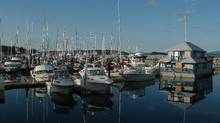 Boats reflected in the water in the marina in Sidney, B.C. (Don Denton For The Globe and Mail)