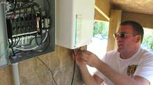 Working on the micro-grid project at the Kortright Conservation Area in Ontario. (Kortright Conservation Area)