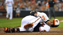 Baltimore Orioles third baseman Manny Machado goes down with a knee injury (Joy R. Absalon/USA Today Sports)