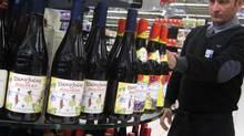 Will shoppers in British Columbia soon be able to purchase their favourite liquor at grocery stores? Changes recommended by the elected official in charge suggest so. (Lionel Cironneau/The Associated Press)