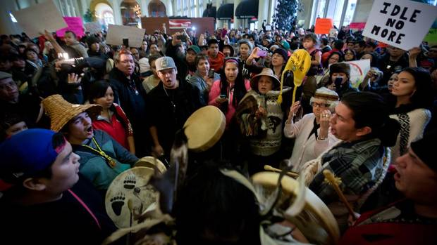 Peaceful demonstrators chant and hold a drum circle during at an Idle No More event at Vancouver's Waterfront Station on Wednesday. (DARRYL DYCK FOR THE GLOBE AND MAIL)