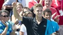 Canada's Filip Peliwo celebrates his victory over Jarkko Nieminen (Paul Chiasson/THE CANADIAN PRESS)