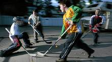 Kids play road hockey in Edmonton on Wednesday, September 22, 2004. Active Healthy Kids Canada released its annual Report Card on Physical Activity for Children and Youth on Tuesday which paints a grim picture of the activity levels of many Canadian youngsters. (JOHN ULAN/THE CANADIAN PRESS)