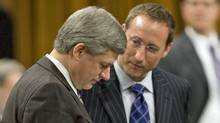 Prime Minister Stephen Harper goes over documents with Defence Minister Peter MacKay in the House of Commons on Nov. 18, 2008. (Tom Hanson/The Canadian Press)
