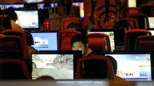 People connect to the Internet at a coffee shop in Beijing. (Liu Jin/AFP/Getty Images)