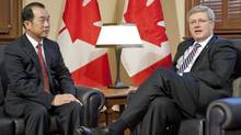 Prime Minister Stephen Harper announces he will visit Beijing in early February as meets with Chinese Ambassador Zhang Junsai in Ottawa on Jan. 11, 2012. (Adrian Wyld/Adrian Wyld/The Canadian Press)