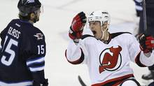 New Jersey Devils' Kurtis Foster (2) celebrates his goal against the Winnipeg Jets during third period NHL action in Winnipeg on Saturday, January 14, 2012. THE CANADIAN PRESS/John Woods (JOHN WOODS)