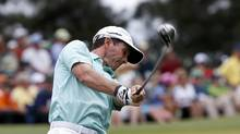 Mike Weir of Canada hits his tee shot on the third hole (MIKE SEGAR/REUTERS)