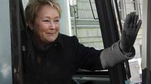 Parti Québécois Leader Pauline Marois waves from her campaign bus as she hits the campaign trail in Quebec on March 5, 2014.