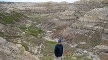 Hiker Paul Haavardsrud studies some of the fragmented rock on the steep incline out of Horsethief Canyon north of Drumheller, Alta. (Dave Ebner/The Globe and Mail)
