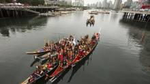 An all Nations Canoe Gathering at Science World in Vancouver September 17, 2013 where they were welcomed in a traditional ceremony to the Coast Salish lands. Canoe gathering marks the opening to the Week of Reconciliation to be held in Vancouver. (John Lehmann/The Globe and Mail)