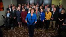 BC Liberal Leader Christy Clark is flanked by MLAs as she answers quesrions from reporter after a meeting of her caucus in Vancouver on Tuesday. (DARRYL DYCK/THE CANADIAN PRESS)