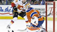 Calgary Flames' Sam Bennett (93) is stopped by Edmonton Oilers goalie Cam Talbot (33) during second period NHL action in Edmonton, Alta., on Saturday January 16, 2016. (JASON FRANSON/THE CANADIAN PRESS)