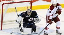 Ondrej Pavelec of the Winnipeg Jets blocks a shot on goal by Shane Doan of the Phoenix Coyotes in NHL action at the MTS Centre on December 1, 2011 in Winnipeg, Manitoba, Canada. (Marianne Helm/2011 Getty Images)