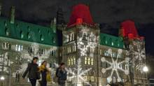Christmas lights reflect on the walls of the Parliament buildings. (FRED CHARTRAND/THE CANADIAN PRESS)