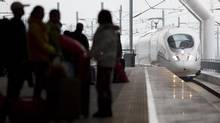A train pulls into the Guangzhou South railway station in Guangzhou January 11, 2013. (John Lehmann/The Globe and Mail)