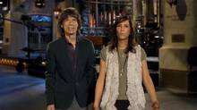 Musican Mick Jagger hosted Saturday Night Live on May 19, 2012. He's seen here on set with departing cast member Kristin Wiig (NBC Screen capture/NBC Screen capture)