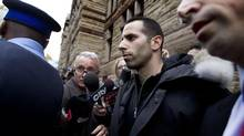 Sandro Lisi, with his lawyer, Seth Weinstein, near, is escorted out of Old City Hall Court in Toronto on Nov. 1, 2013 after getting bail on extortion charges. (Peter Power/The Globe and Mail)